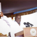 Akufo Addo with the cover documen