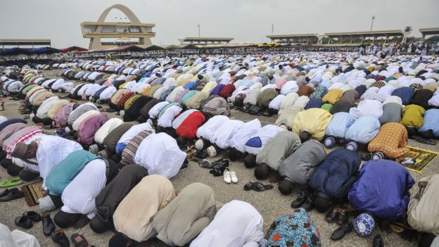 People pray during the celebration of the Eid al-Fitr at Independence Square in Accra, Ghana - June 2017