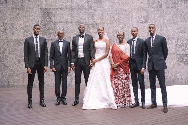 Paul Kagame with his wife and sons at his daughter's wedding.