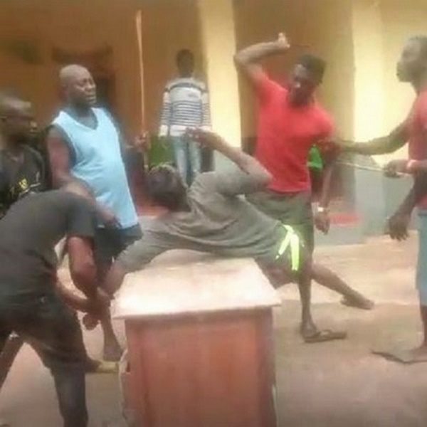 The young man captured being beaten for flouting the chief's orders