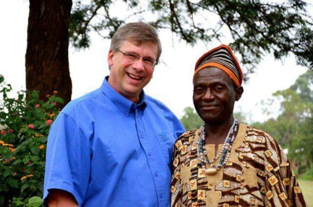 Bible translator Angus Fung (R) poses for a photo with Tearfund Canada President Wayne Johnson (L) in Wum, Cameroon