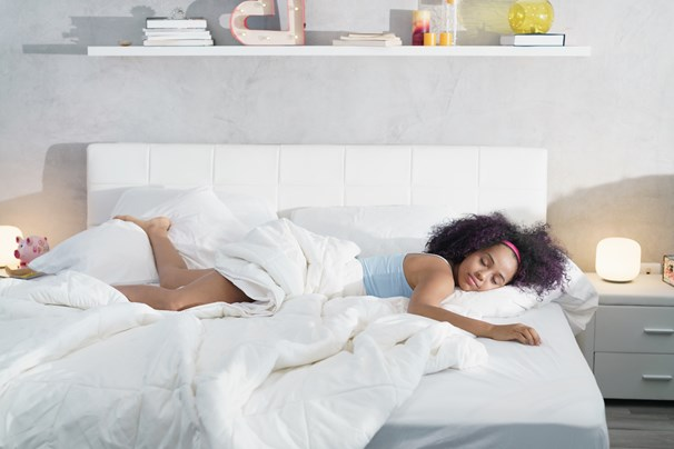 woman sleeping on a bed