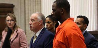 R Kelly handcuffed
