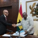 President Akufo-Addo receiving the report from Justice Emile Short