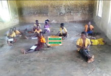 classroom pupils sit on bare floor