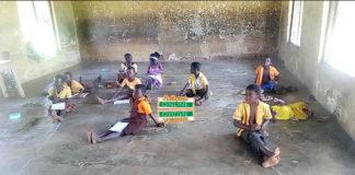 classroom pupils sit on bare floor