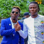 Shatta Wale (L) and Stonebwoy smoke the peace pipe