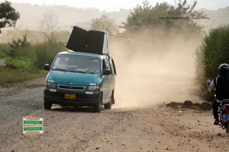 Dust engulfs road from Peki, Todome to Have.