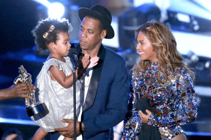 Blue Ivy Carter, Jay Z and Beyonce onstage during the 2014 MTV Video Music Awards at The Forum on August 24, 2014 in Inglewood, California. (Photo by Mark Davis/Getty Images)