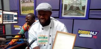 Enoch Kwesi Worlanyo displaying his award