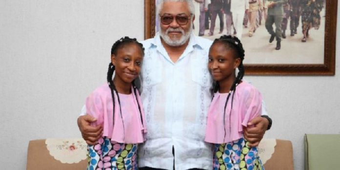 The twins in a photograph with former President John Rawlings