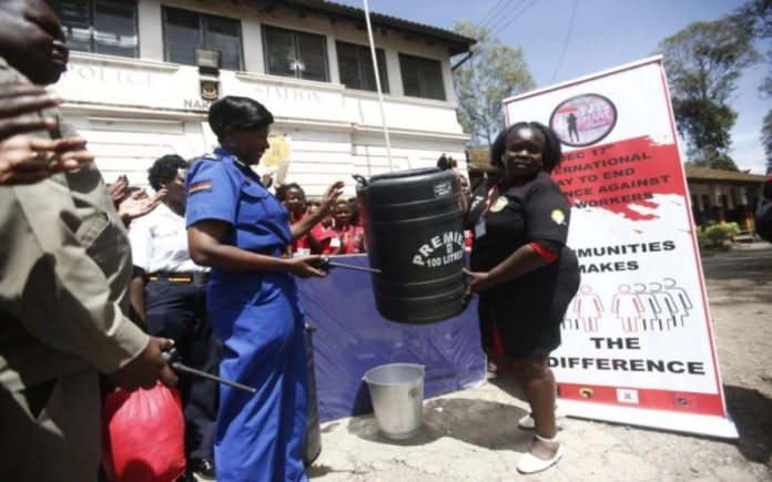 Sex workers donate items to police (Photos/Kipsang)