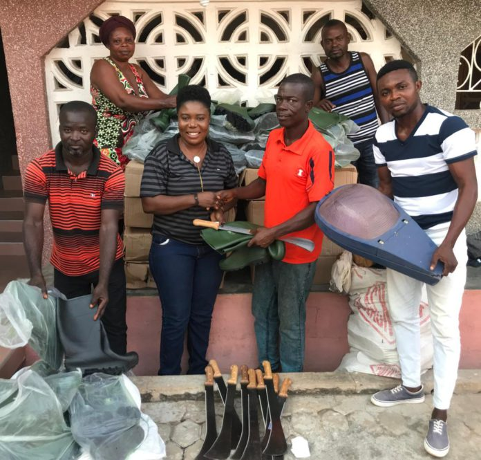 Rachel Appoh handing over the items to the leadership of Gomoa Youth in Agric