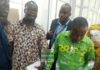 Forrmer District Finance Officer for sefwi Akontombra assembly Isaac Akowuah and the Current Officer James Esilfie in handcuffs being taken away by the police