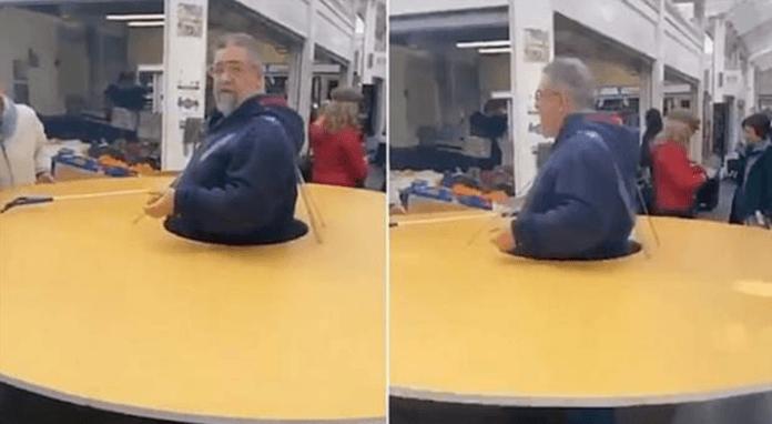 Italian man wears giant cardboard circle to enforce social distancing