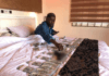 Shatta Wale shows off his money in bed