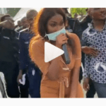 Wendy Shay performs with nose mask at a gathering