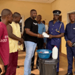 John Dumelo has donated detergents, soaps, gloves and other items to five police stations