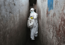 PHOTO: A Red Cross burial team wore protective clothing to visit houses where people were infected with Ebola. (Getty Images: John Moore)