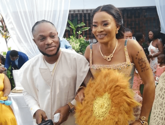 Keche Andrew and his wife Joana during their wedding | Photo: @joanagyancudjoe/ Instagram