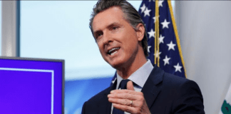 Governor Gavin Newsom discusses an outline for what it will take to lift coronavirus restrictions during a news conference at the Governor''s Office of Emergency Services in Rancho Cordova [File: Rich Pedroncelli/AP Photo]