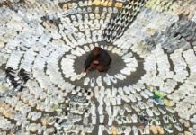 Kanye West surrounded by hundreds of Yeezys