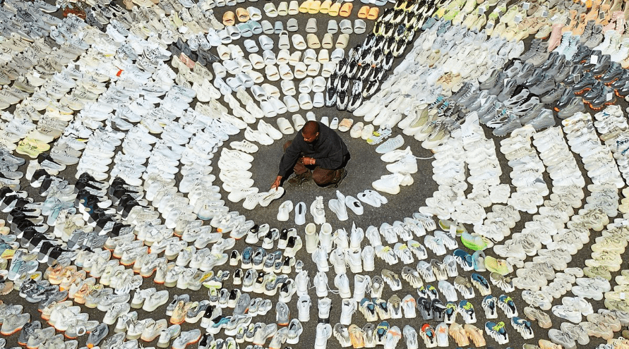 Kanye West surrounded by hundreds of Yeezys