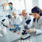 Laboratory scientists working in a lab