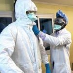 Health Workers putting on Personal Protective Equipment (PPE)