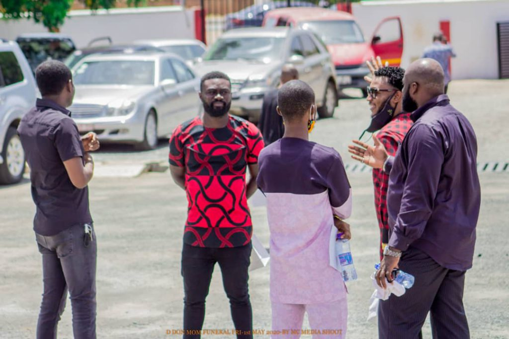 Hitz FM's Mic Gizo faces the camera (red and black shirt)