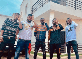 Shatta Wale and his Shatta Movement militants pose in front of his mansion at East Legon
