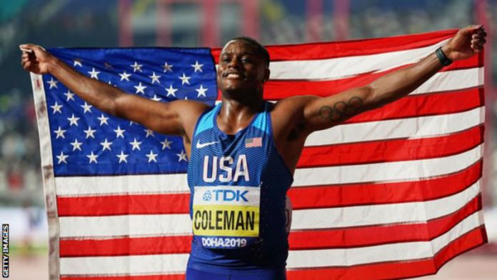 Christian Coleman celebrates his gold medal at the Doha World Championships in 2019