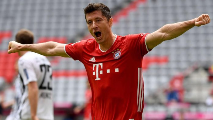 Robert Lewandowski celebrates after scoring his team's second goal during the German first division Bundesliga football match FC Bayern Munich v SC Freiburg on June 20, 2020 Image credit: Getty Images