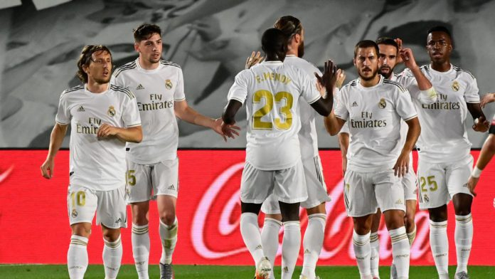 Real Madrid's Brazilian forward Vinicius Junior (R) celebtrates with teammates after scoring during the Spanish League football match Real Madrid CF against RCD Mallorca at at the Alfredo di Stefano stadium Image credit: Getty Images