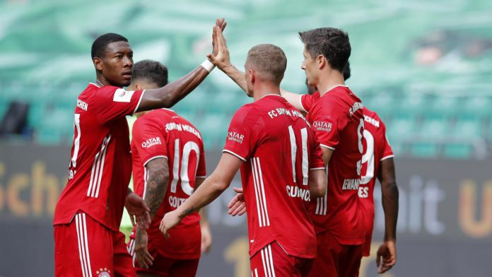 Robert Lewandowski of Bayern Muenchen celebrates the third goal for his team with Michael Cuisance of Bayern Muenchen and David Alaba of Bayern Muenchen during the Bundesliga match between VfL Wolfsburg and FC Bayern Muenchen at Volkswagen Arena on June 2 Image credit: Getty Images