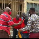 The NDC pastor (in red shirt ) was picked up at his house on Tuesday during a radio interview