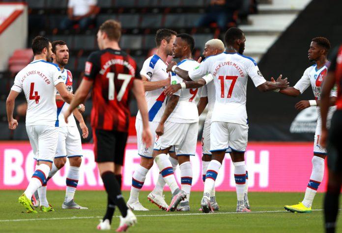 Jordan Ayew celebrates with his Palace teammates