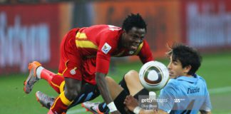 JOHANNESBURG, SOUTH AFRICA - JULY 02: Jorge Fucile of Uruguay tackles Samuel Inkoom of Ghana during the 2010 FIFA World Cup South Africa Quarter Final match between Uruguay and Ghana at the Soccer City stadium on July 2, 2010 in Johannesburg, South Africa. (Photo by Clive Rose/Getty Images)