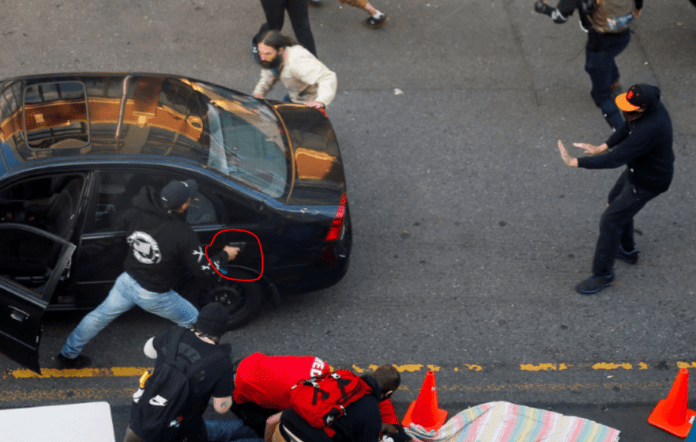 Man drives car toward Seattle protesters then shoots one, police say