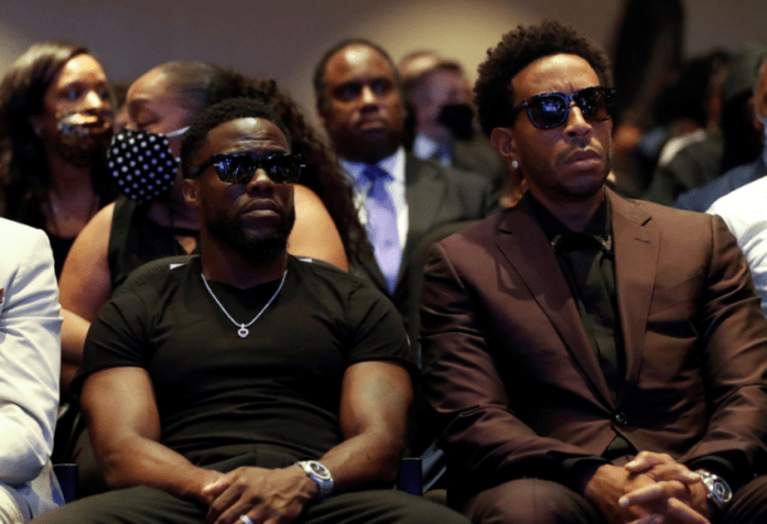Actor Kevin Hart and musician Ludacris are seen during a memorial service for George Floyd today.REUTERS