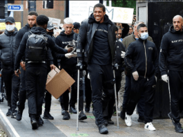 Anthony Joshua hobbles on crutches as he joins Black Lives Matter protest