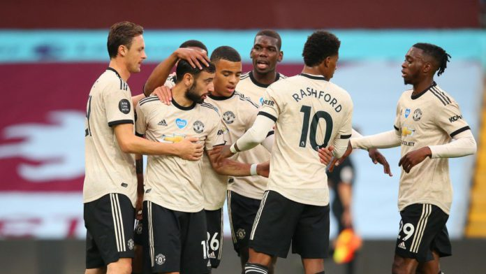 Bruno Fernandes of Manchester United celebrates with team mates after scoring the opening goal from a penalty kick during the Premier League match between Aston Villa and Manchester United at Villa Park Image credit: Getty Images