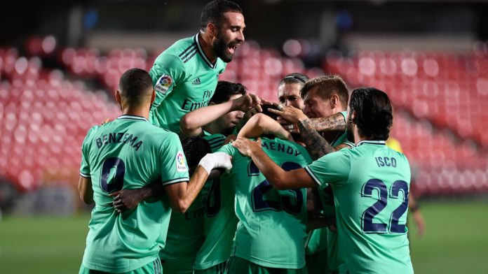 Real Madrid's players celebrate after French defender Ferland Mendy scored during the Spanish league football match Granada FC vs Real Madrid CF at Nuevo Los Carmenes stadium in Granada on July 13, 2020. Image credit: Getty Images