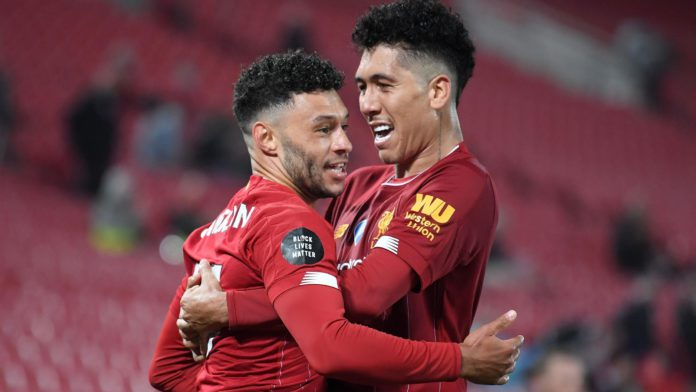 Alex Oxlade-Chamberlain (L) celebrates with Roberto Firmino after scoring for Liverpool against Chelsea. Image credit: Getty Images