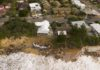 CENTRAL COAST, AUSTRALIA - JULY 17: An aerial view of the coastal erosion to local homes in the suburb of Wamberal on July 17, 2020 in Central Coast, Australia. Beachfront homes along the NSW Central Coast are at risk of collapse due to beach erosion after huge swells hit the states beaches on Thursday. (Photo by James D. Morgan/Getty Images)