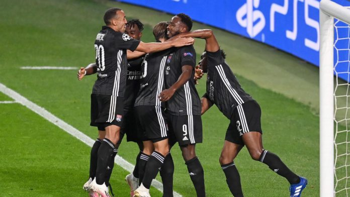 Olympique Lyon players celebrate following their team's victory in the UEFA Champions League Quarter Final match between Manchester City and Lyon at Estadio Jose Alvalade on August 15, 2020 in Lisbon, Portugal Image credit: Getty Images