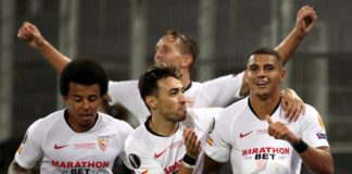 Diego Carlos of Sevilla FC (R) and team mates celebrate their team's third goal, an own goal scored by Romelu Lukaku of Inter Milan (not pictured) during the UEFA Europa League Final between Seville and FC Internazionale at RheinEnergieStadion on August 2 Image credit: Getty Images