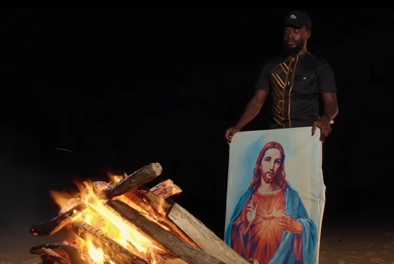 Fuse ODG burns a portrait of Jesus Christ to wake Africans up