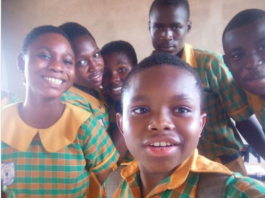 Gideon Nhyiraba and some of his classmates take a picture after writing BECE