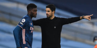 MANCHESTER, ENGLAND - OCTOBER 17: Thomas Partey of Arsenal gets some instructions from Arsenal Manager Mikel Arteta during the Premier League match between Manchester City and Arsenal at Etihad Stadium on October 17, 2020 in Manchester, England. (Photo by David Price/Arsenal FC via Getty Images)